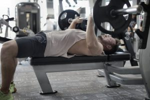 man and a weight bench