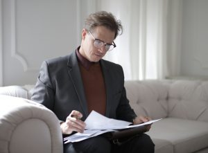 Divorce lawyer in Sydney looking through some papers