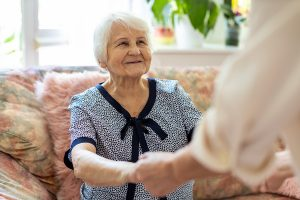 Old woman meeting an aged care financial planning representative