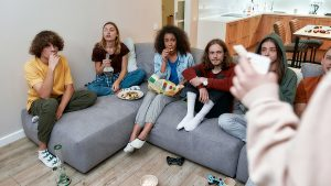 Young people on the couch smoking on bongs
