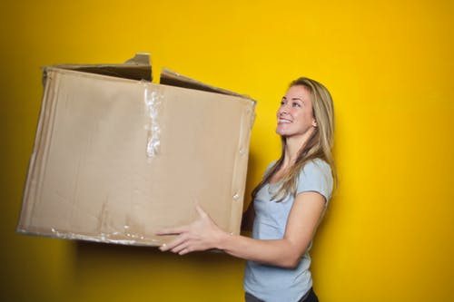 Woman carrying a huge box